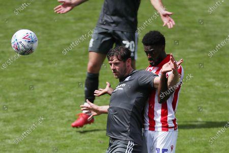 Lukas Jutkiewicz of Birmingham City and Bruno Martins Indi of Stoke City