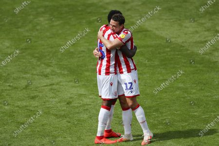 Bruno Martins Indi and James Chester of Stoke City embrace after the final whistle