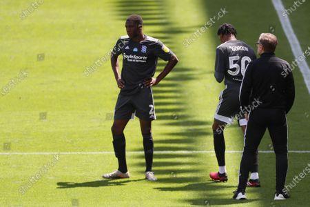 Birmingham City coachSteve Spooner speak with players during a drinks break