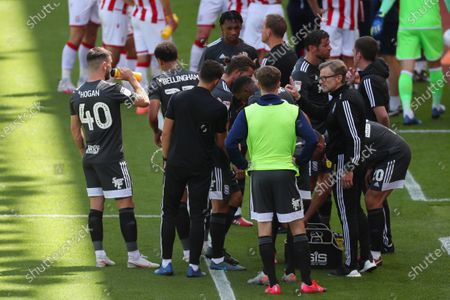 Birmingham City coaches Craig Gardner and Steve Spooner speak with players during a drinks break