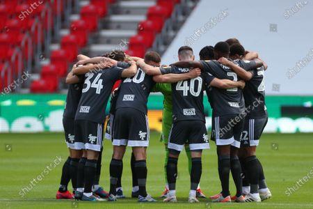 Birmingham City players huddle before kick-off