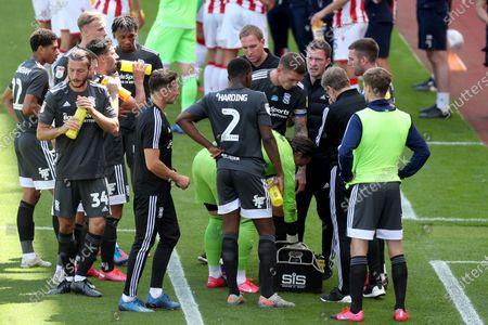 Birmingham City Coaches Steve Spooner and Craig Gardner speak to players during a drinks break