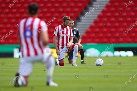 Nick Powell of Stoke City takes a knee in support of Black Lives Matter before kick-off