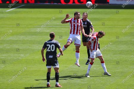 Harlee Dean of Birmingham City competes with Nick Powell and Sam Vokes of Stoke City
