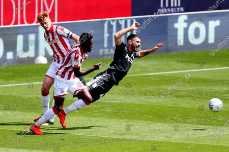 Scott Hogan of Birmingham City is fouled by Sam Clucas and Bruno Martins Indi of Stoke City