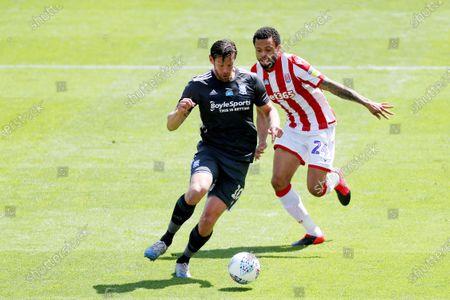 Lukas Jutkiewicz of Birmingham City and Jordan Cousins of Stoke City