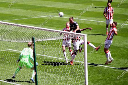 Scott Hogan of Birmingham City heads at goal