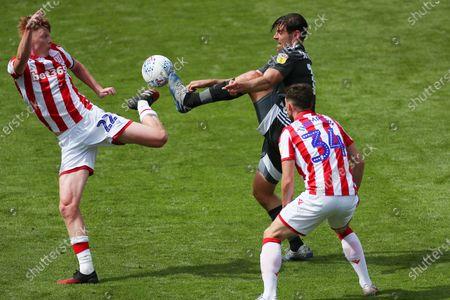 Sam Clucas of Stoke City and Lukas Jutkiewicz of Birmingham City