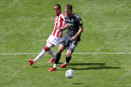 Tom Ince of Stoke City and Gary Gardner of Birmingham City
