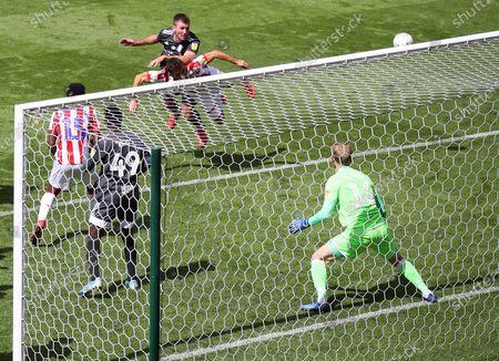 Gary Gardner of Birmingham City heads at goal