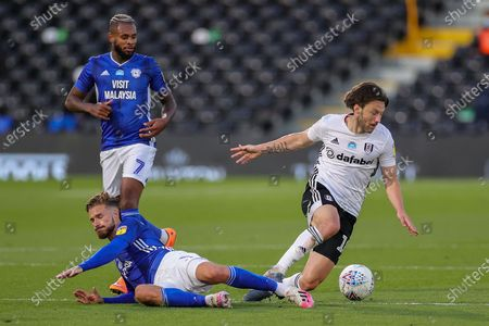 Cardiff City defender Joe Bennett (3) tussles with Fulham midfielder Harry Arter (18) during the EFL Sky Bet Championship match between Fulham and Cardiff City at Craven Cottage, London