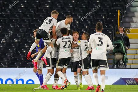 Goal! Fulham midfielder Joshua Onomah (25) (obscured in picture)scores a goal and celebrates 2-0  during the EFL Sky Bet Championship match between Fulham and Cardiff City at Craven Cottage, London