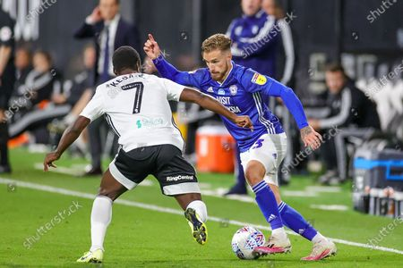 Cardiff City defender Joe Bennett (3) tries to go past Fulham midfielder Neeskens Kebano (7) during the EFL Sky Bet Championship match between Fulham and Cardiff City at Craven Cottage, London