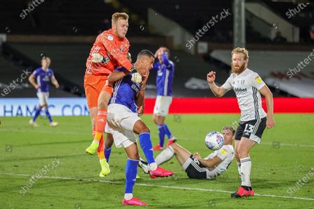 Fulham goalkeeper Marek Rodak (12) punches away from Cardiff City forward Robert Glatzel (9) during the EFL Sky Bet Championship match between Fulham and Cardiff City at Craven Cottage, London