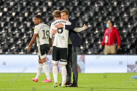 Fulham Head Coach Scott Parker celebrates at full time with Fulham midfielder Stefan Johansen (8) during the EFL Sky Bet Championship match between Fulham and Cardiff City at Craven Cottage, London