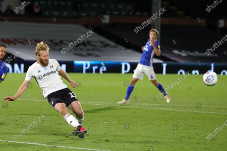 Fulham defender Tim Ream (13) clears the ball during the EFL Sky Bet Championship match between Fulham and Cardiff City at Craven Cottage, London