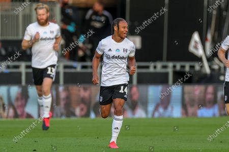 Fulham midfielder Bobby Decordova-Reid (14) leads Fulham out on to the pitch during the EFL Sky Bet Championship match between Fulham and Cardiff City at Craven Cottage, London