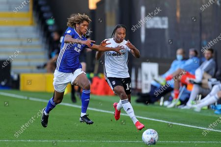 Cardiff City defender Dion Sanderson (2) tussles with Fulham midfielder Bobby Decordova-Reid (14) during the EFL Sky Bet Championship match between Fulham and Cardiff City at Craven Cottage, London
