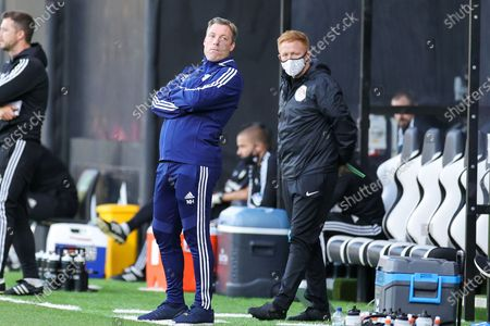 Cardiff City Manager Neil Harris leans back to view play during the EFL Sky Bet Championship match between Fulham and Cardiff City at Craven Cottage, London