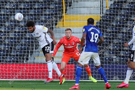 Fulham defender Cyrus Christie (22) heads clear during the EFL Sky Bet Championship match between Fulham and Cardiff City at Craven Cottage, London