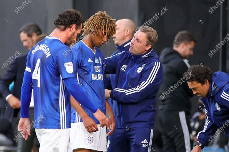 Cardiff City Manager Neil Harris talks to Cardiff City defender Dion Sanderson (2) during the refreshment break during the EFL Sky Bet Championship match between Fulham and Cardiff City at Craven Cottage, London