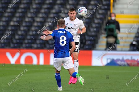 Fulham defender Joe Bryan (23) heads the ball during the EFL Sky Bet Championship match between Fulham and Cardiff City at Craven Cottage, London