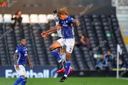 Cardiff City defender Dion Sanderson (2) and Fulham defender Joe Bryan (23) clash in the air during the EFL Sky Bet Championship match between Fulham and Cardiff City at Craven Cottage, London