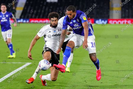 Fulham defender Cyrus Christie (22) challenges Cardiff City forward Nathaniel Mendez-Laing (19) during the EFL Sky Bet Championship match between Fulham and Cardiff City at Craven Cottage, London