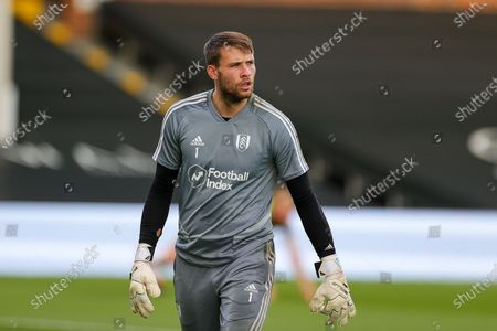 Fulham goalkeeper Marcus Bettinelli (1) warms up during the EFL Sky Bet Championship match between Fulham and Cardiff City at Craven Cottage, London
