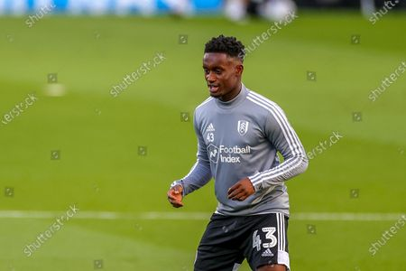 Fulham defender Steven Sessegnon (43) warms up during the EFL Sky Bet Championship match between Fulham and Cardiff City at Craven Cottage, London