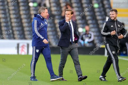 Fulham Head Coach Scott Parker and Cardiff City Manager Neil Harris walk on to the pitch during the EFL Sky Bet Championship match between Fulham and Cardiff City at Craven Cottage, London
