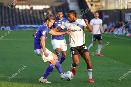 Fulham midfielder Joshua Onomah (25) tussles with Cardiff City defender Will Vaulks (6) during the EFL Sky Bet Championship match between Fulham and Cardiff City at Craven Cottage, London