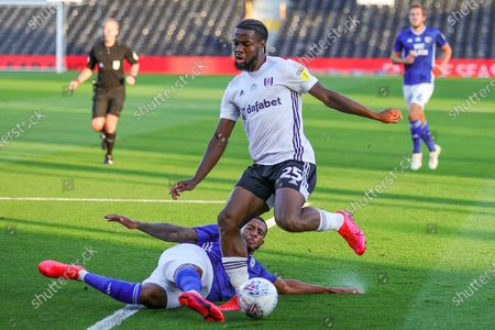 Cardiff City forward Nathaniel Mendez-Laing (19) tackles Fulham midfielder Joshua Onomah (25) during the EFL Sky Bet Championship match between Fulham and Cardiff City at Craven Cottage, London
