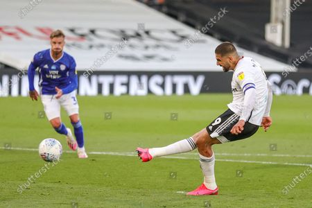 Fulham forward Aleksandar Mitrovic (9) scores from the penalty spot 1-0 during the EFL Sky Bet Championship match between Fulham and Cardiff City at Craven Cottage, London