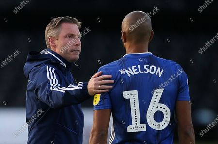 Cardiff City Manager Neil Harris with Curtis Nelson of Cardiff City.
