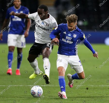 Neeskens Kebano of Fulham is challenged by Joe Bennett of Cardiff City.