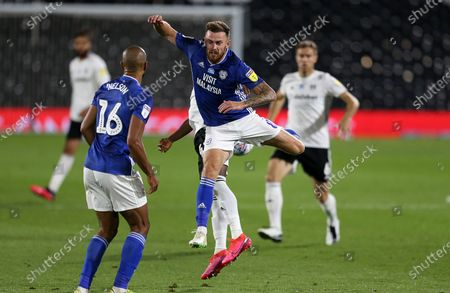 Joe Ralls of Cardiff City is challenged by Steven Sessegnon of Fulham.