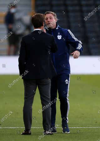Cardiff City Manager Neil Harris with Fulham Manager Scott Parker.