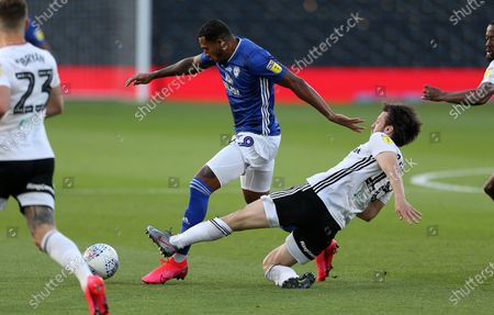 Nathaniel Mendez-Laing of Cardiff City is challenged by Harry Arter of Fulham.