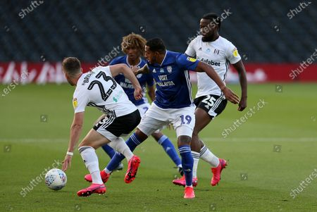Nathaniel Mendez-Laing of Cardiff City is challenged by Joe Bryan of Fulham.