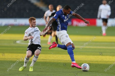 Nathaniel Mendez-Laing of Cardiff City is challenged by Harrison Reed of Fulham.