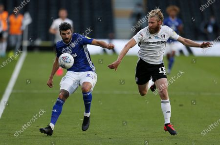 Callum Paterson of Cardiff City is challenged by Tim Ream of Fulham.