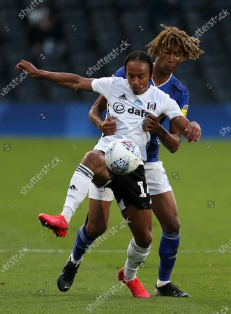 Bobby Reid of Fulham is challenged by Dion Sanderson of Cardiff City.