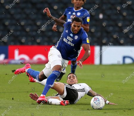 Nathaniel Mendez-Laing of Cardiff City is tackled by Anthony Knockaert of Fulham.