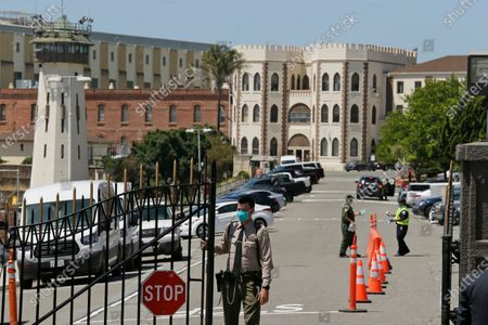 A correctional officer closing the main gate at San Quentin State Prison in San Quentin, Calif. California is giving more than 100,000 state inmates earlier release dates in its latest response to the pandemic, building on earlier steps that together could free nearly 10% of prisoners as Gov. Gavin Newsom responds to intensifying pressure from advocates, lawmakers and federal judges