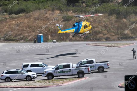 A search helicopter lands after looking for missing US actress Naya Rivera on Lake Piru as searches continue after her disappearance while boating with her young son in Los Padres National Forest, California, USA, 10 July 2020. Rivera starred in the 'Glee' television show, and went missing after renting a boat and going out on the lake with her four-year-old son on 08 July.