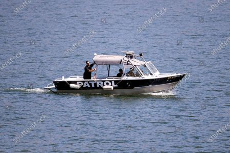 A search boat looks for missing US actress Naya Rivera on Lake Piru as searches continue after her disappearance while boating with her young son in Los Padres National Forest, California, USA, 10 July 2020. Rivera starred in the 'Glee' television show, and went missing after renting a boat and going out on the lake with her four-year-old son on 08 July.