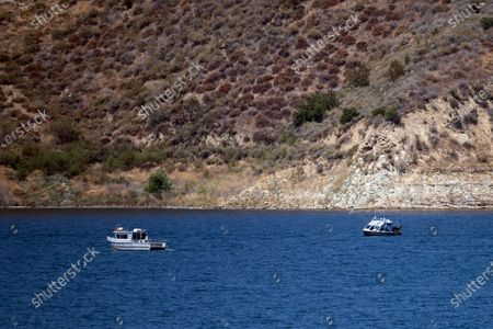 Search boats look for missing US actress Naya Rivera on Lake Piru as searches continue after her disappearance while boating with her young son in Los Padres National Forest, California, USA, 10 July 2020. Rivera starred in the 'Glee' television show, and went missing after renting a boat and going out on the lake with her four-year-old son on 08 July.