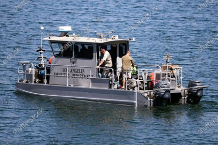 Los Angeles Sheriffs Department boat looks for missing US actress Naya Rivera on Lake Piru as searches continue after her disappearance while boating with her young son in Los Padres National Forest, California, USA, 10 July 2020. Rivera starred in the 'Glee' television show, and went missing after renting a boat and going out on the lake with her four-year-old son on 08 July.
