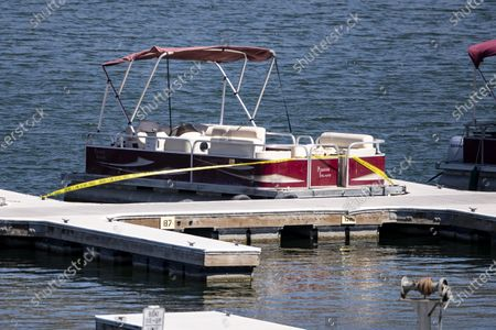 Police tape is displayed on the boat used by US actress Naya Rivera as searches continue after her disappearance while boating with her young son in Los Padres National Forest, California, USA, 10 July 2020. Rivera starred in the 'Glee' television show, and went missing after renting a boat and going out on the lake with her four-year-old son on 08 July.